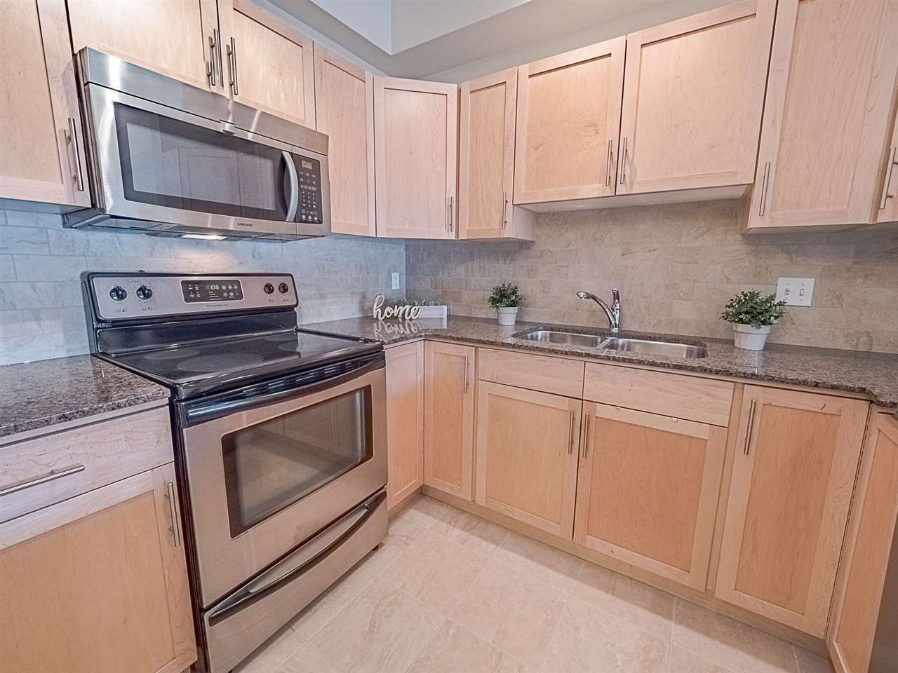 Photo of #206 2035 Grantham Court NW